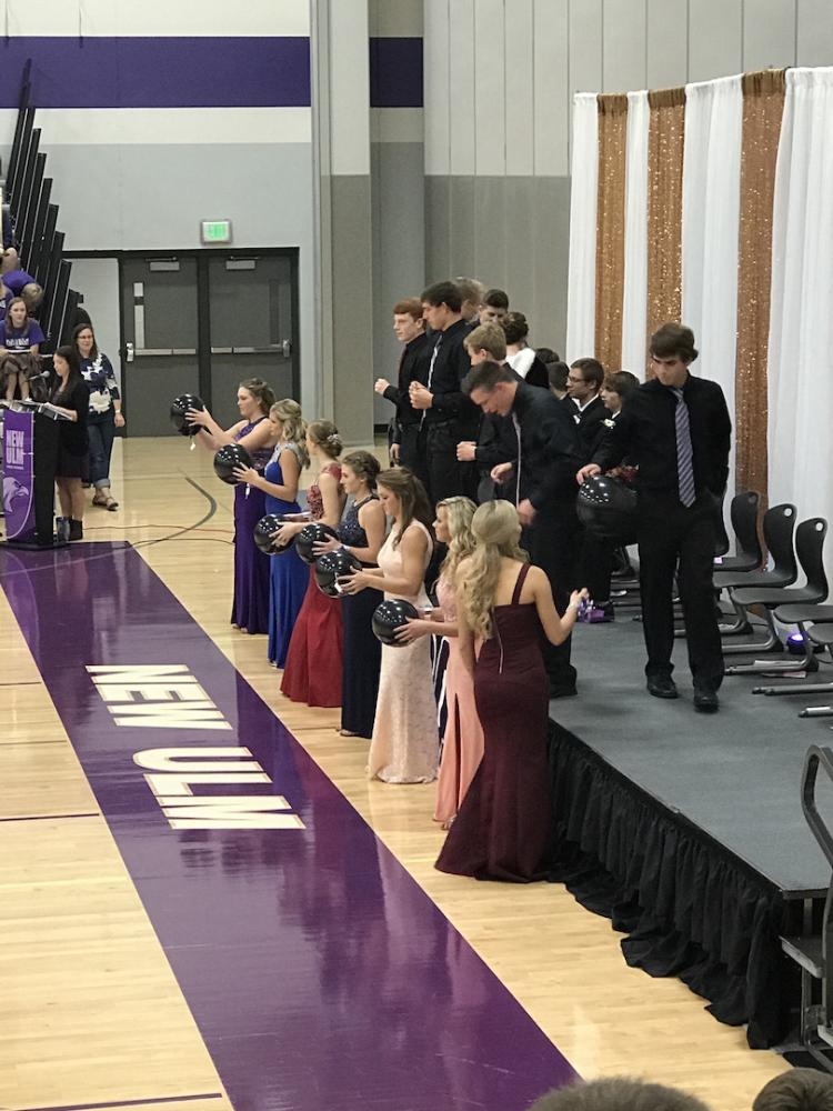 Queen candidates and their escorts getting ready to find out who is homecoming queen