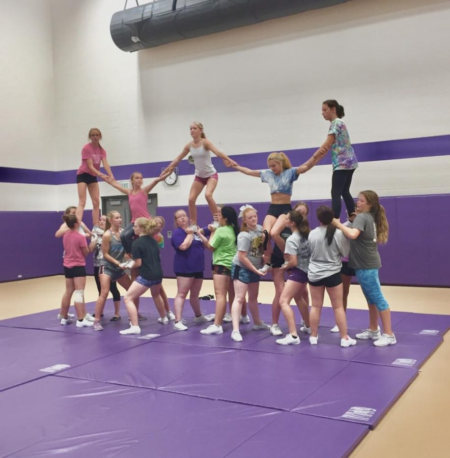 The cheer team of NUHS attempting an awesome stunt during a practice.