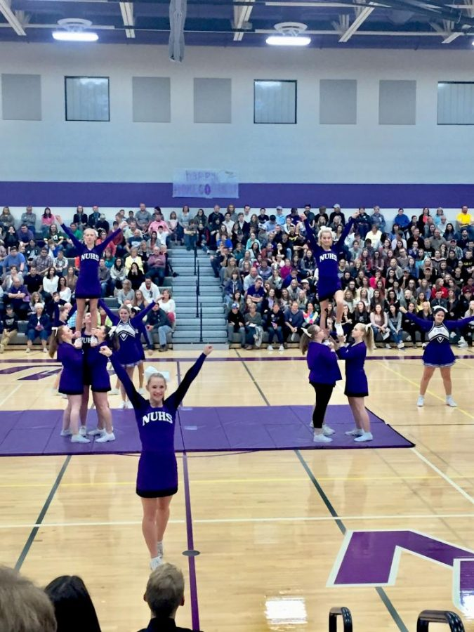 Our cheer team doing some wicked stunts during Homecoming Week!