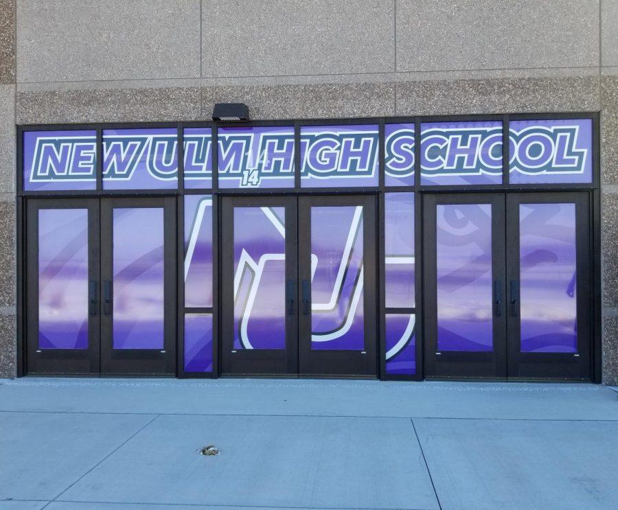 Door+14.+NUHS+showing+their+school+spirit+with+a+large+door+sticker+on+the+doors+facing+the+football+field.