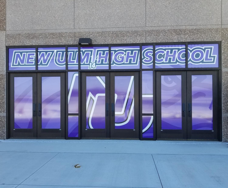 Door 14. NUHS showing their school spirit with a large door sticker on the doors facing the football field.