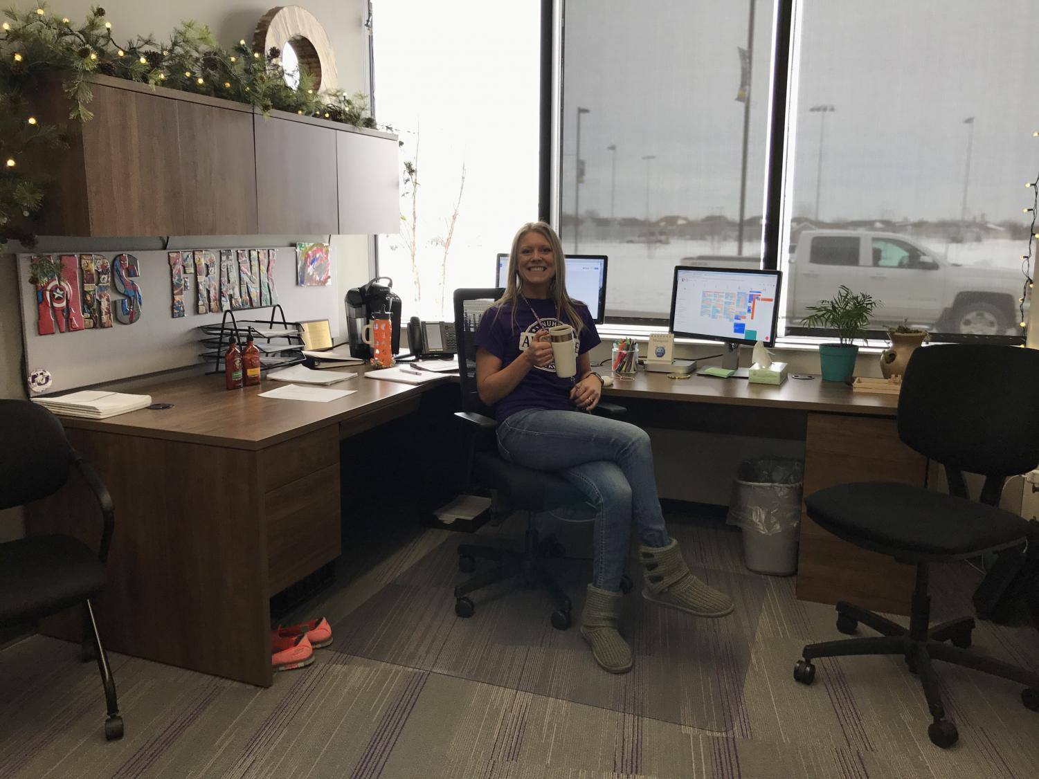 Mrs. Frank sits in her cozy office drinking coffee.