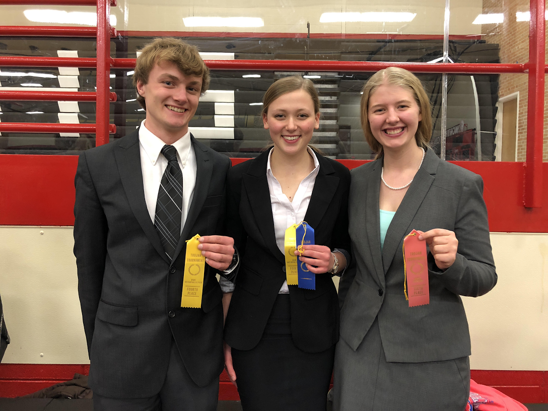 Photo Courtesy of Lucas Van Leeuwe. Nicholas Schultz (left) and Emma Maudal (center) teamed together to take fourth as a duo. Bethany Jassen (right) took sixth as a great speaker.
