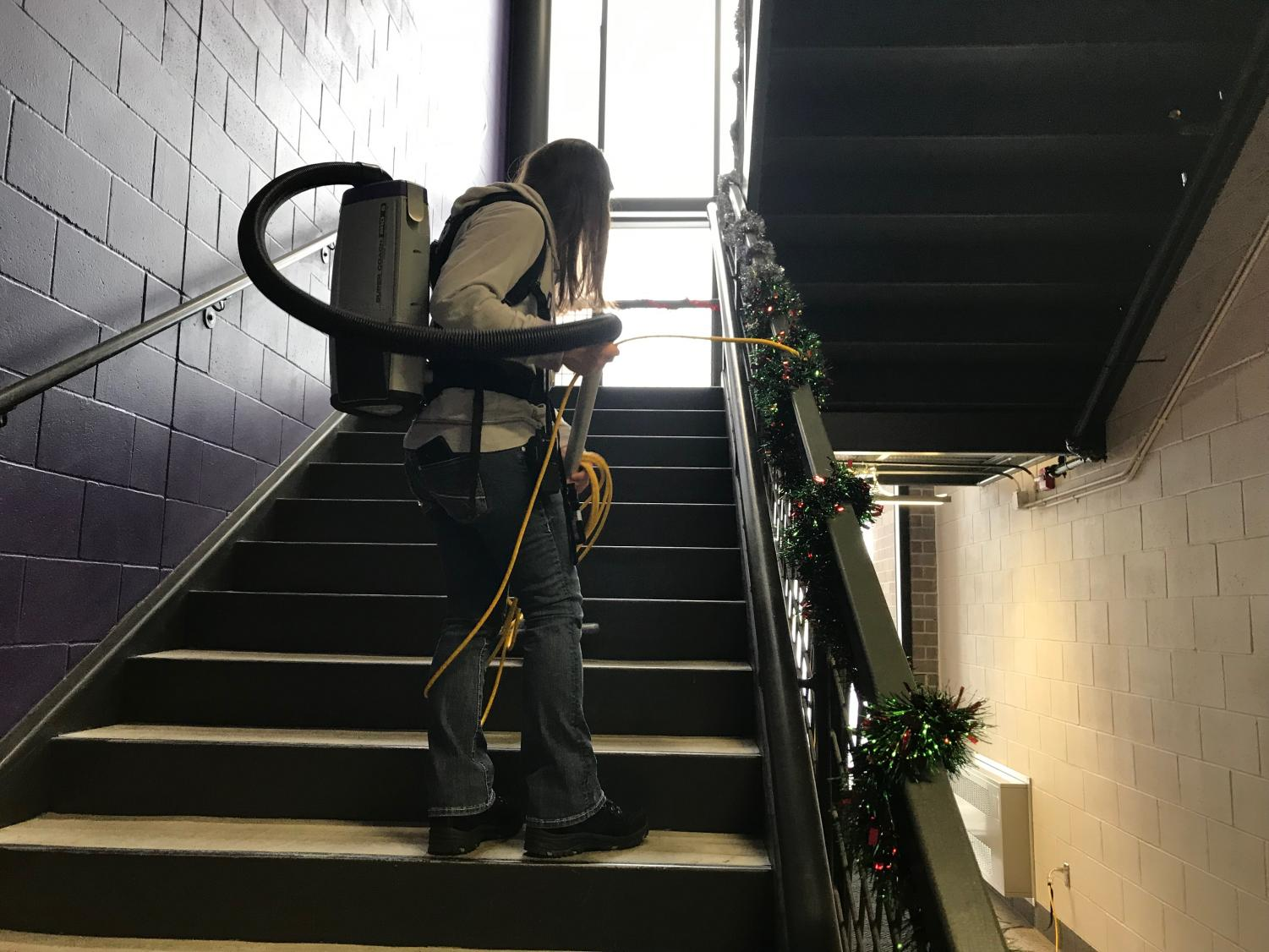 Vac Pack or Jet Pack? Head Custodian Sandy Stitzinger keeping the stairwell in ship shape