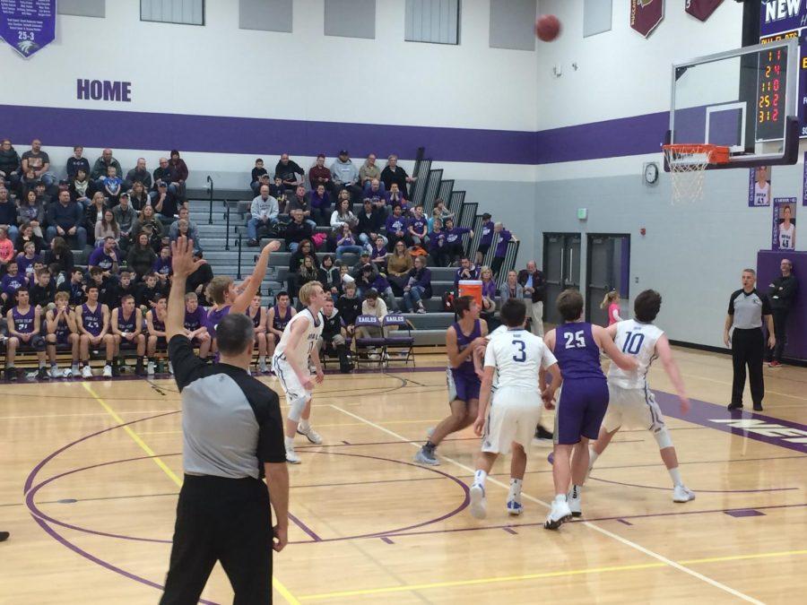 Senior+Braden+Zimmerman+takes+a+free-throw+shot+as+the+New+Ulm+Eagles+Boys+Basketball+team+clinch+their+first+win+of+the+season.+