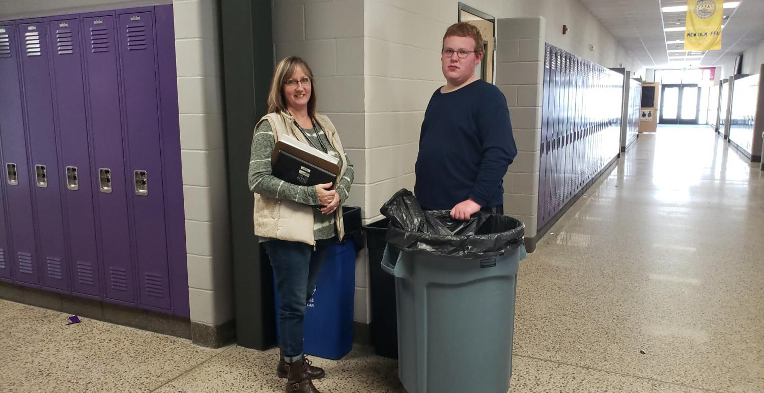 WORK IN PROGRESS - Senior Erik Zobel and Kathy Wendland herself pause their work to pose for a picture.