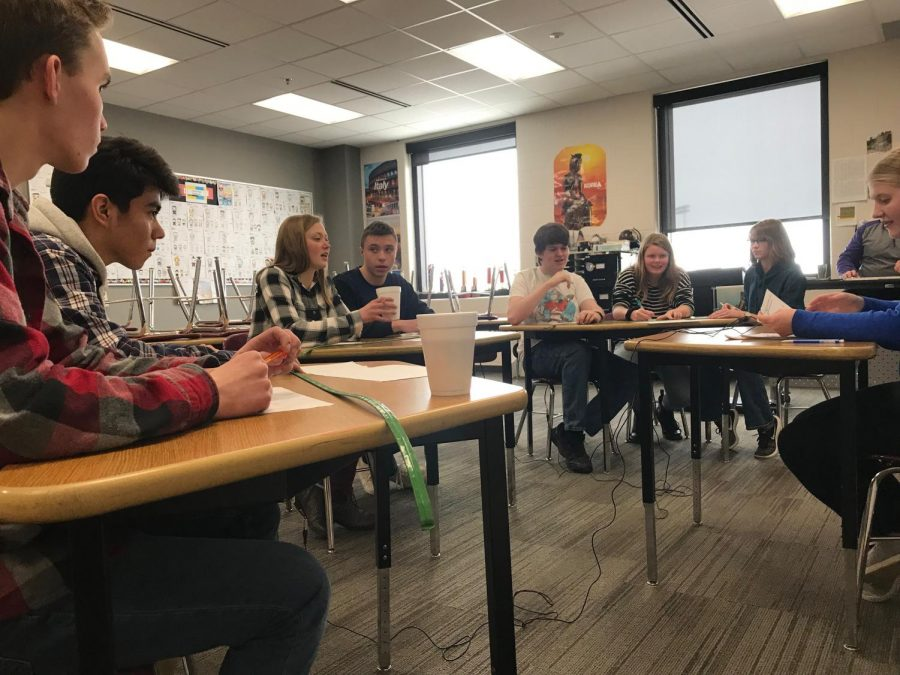 Seniors Emma Maudal and Peter Spengler, middle, have been known to know their fair share of answers to Knowledge Bowl questions.