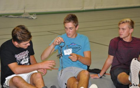 Cathedral students attempting to figure out a puzzle.