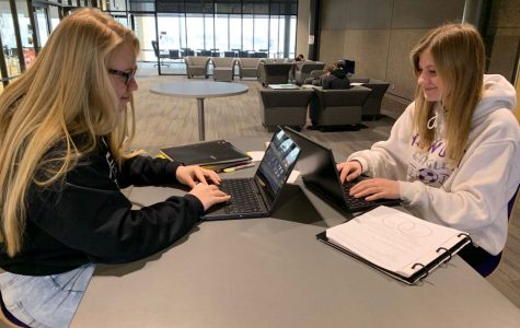 Seniors Brenna Barstad and Rebekah Friendshuh working on homework on their chromebooks in the upper commons