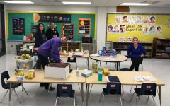 Teachers preparing supplies for distance learning