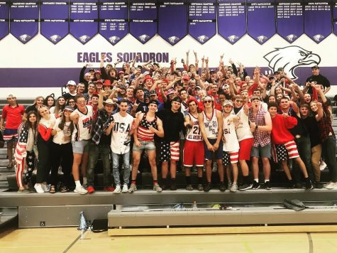 NUHS students cheering on the girls volleyball team