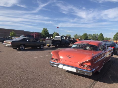 Unifying the community while social distancing with a drive by car show