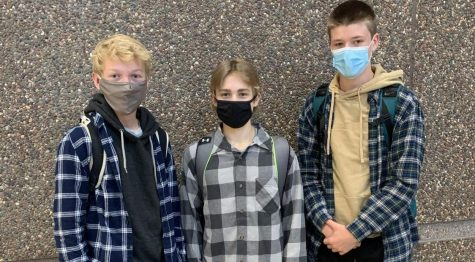 Students (from left to right) Adam Wiltscheck, Bryer Lang, and James Osborne dressed up in flannels for flannel day.