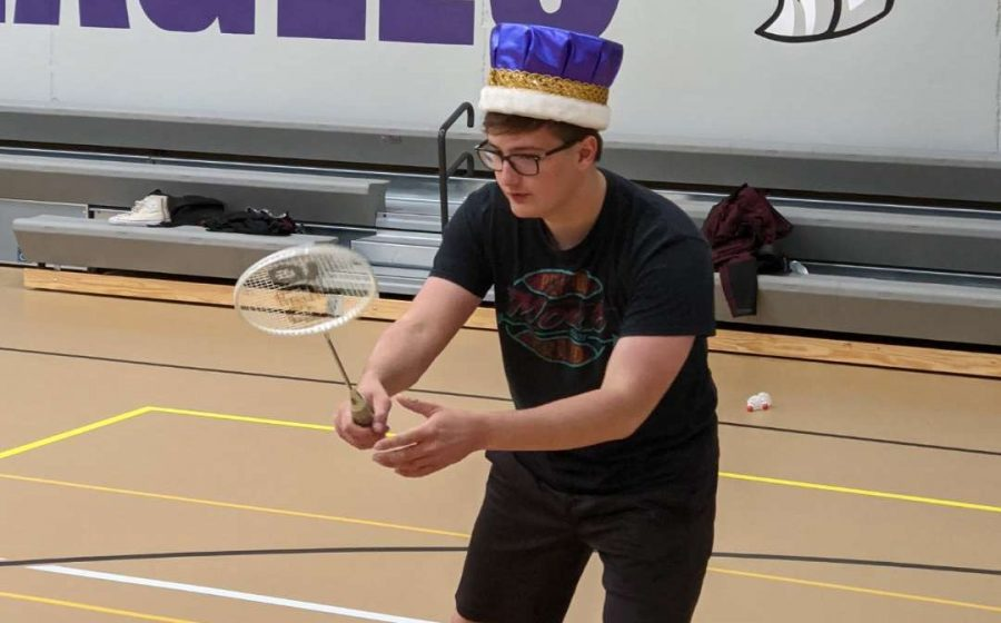 "Isaac Davis wears his crown in a game of badminton on Thursday, November 12. Davis was crowned homecoming king earlier in the week during the annual coronation. Taking Thursday's purple and white dress-up day as an opportunity to show off his crown, Davis wore it to his classes. ""I just had to let everybody know who's really in charge at this school,"" said Davis."