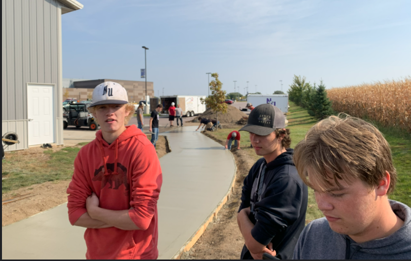 "The carpentry 1 class was seen on a friday coming in to help and learn how to pour concrete for the school. Senior Evan Wiltscheck said, ""It was a fun and new experience that I think everyone learned a lot from."" The class did everything from the pouring and spreading to the texture and rebar."