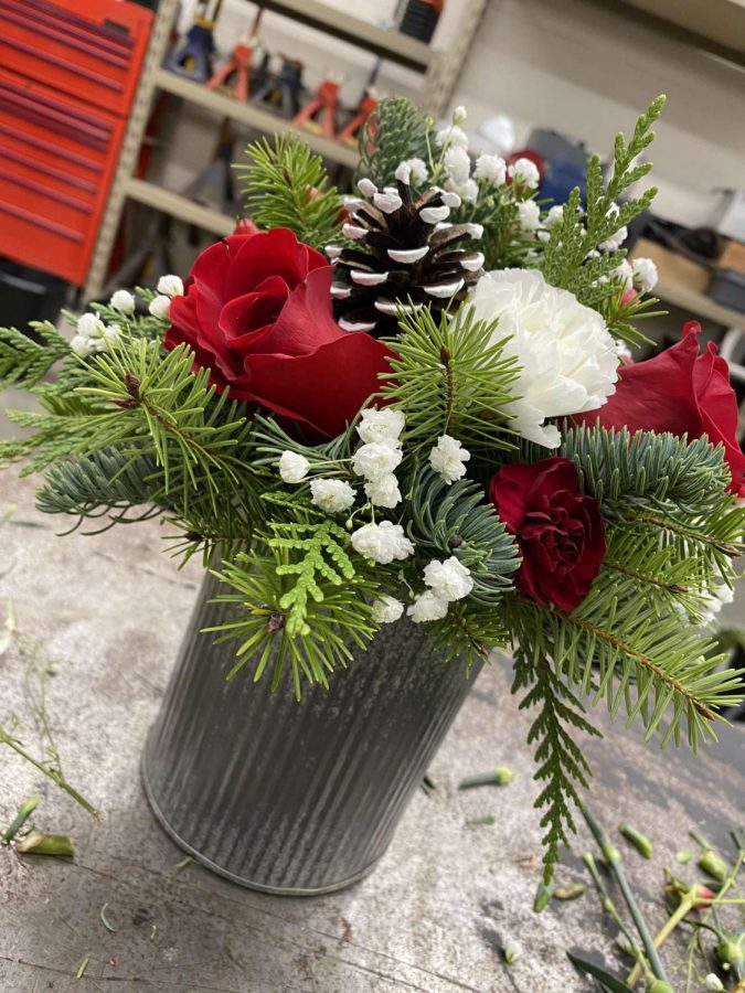 New Ulm High School Eagle Enterprise Class makes flower arrangements for Christmas.