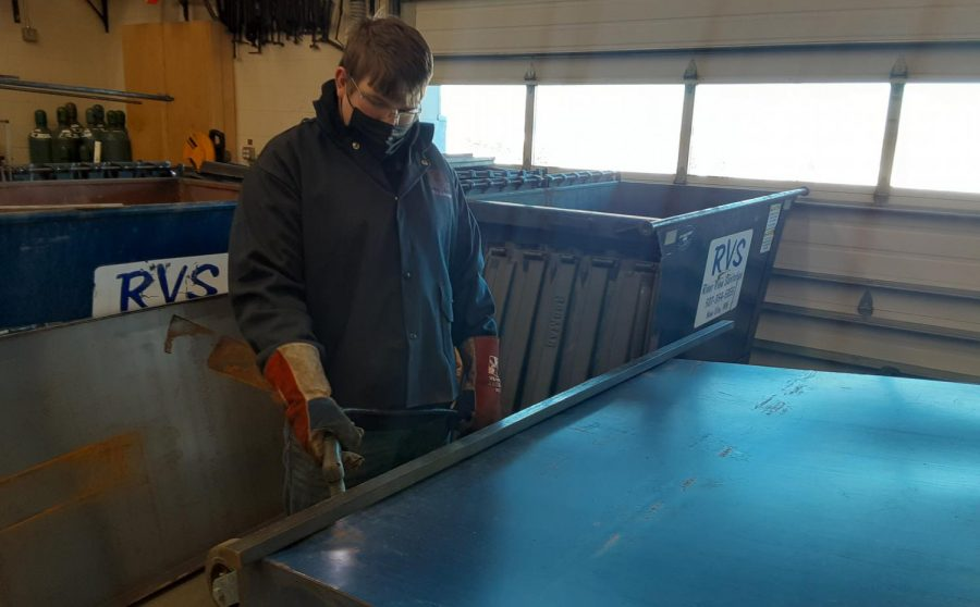 "Here we see Bryce Roiger Cutting the old bottom off of a dumpster for 6th hour welding class at New Ulm High School, so it can be replaced. When interviewed, Bryce said: ""That"