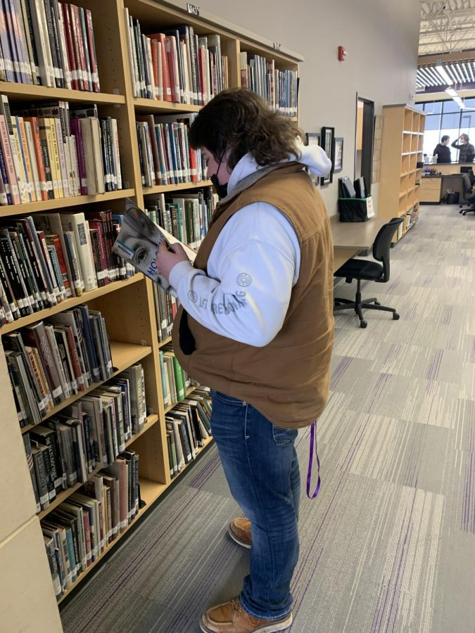 "Student Aiden Guggisburg makes a visit to the high school library to study up on the history of the holocaust. Aiden quotes ""Reading about historical events is exciting and interesting for me."""