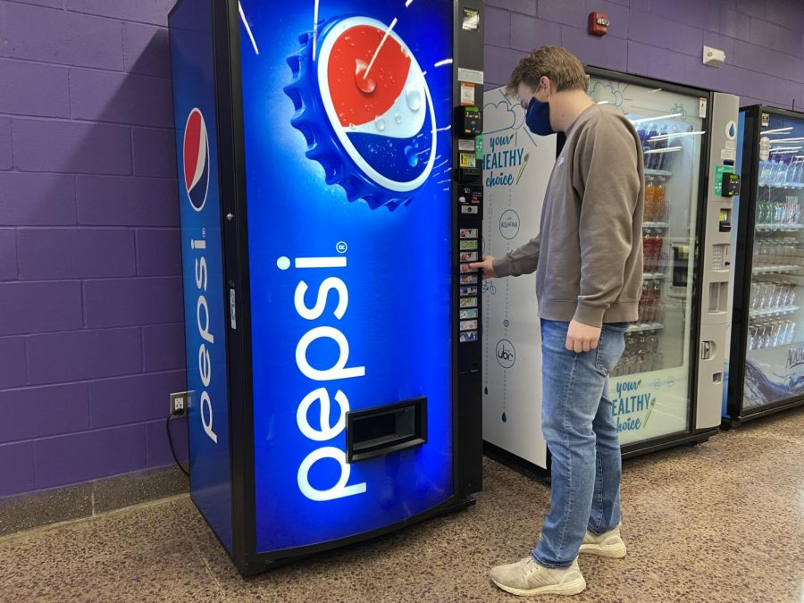 On Monday, senior Carson Helget was seen buying a drink from one of the vending machines in the High School cafeteria to quench his thirst. He was complaining that all of the drinks were diet and thought there should be more of a variety.