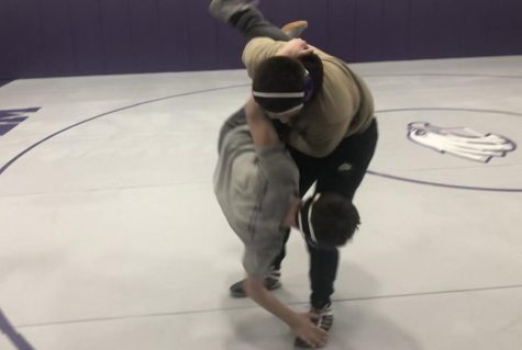Dylen Carreon takes down another wrestler in practice