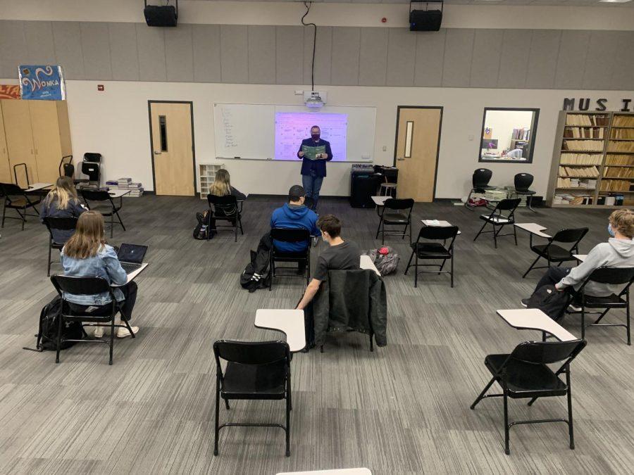 New Ulm High School teacher Mr. Skar reading Shakespeare's Macbeth aloud to his World Lit class