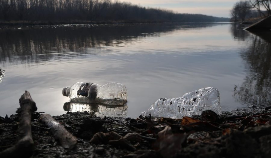 Water Bottles scattered around and in the Minnesota River