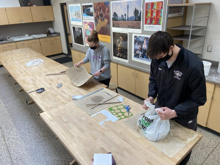 Senior students Nicole Albrecht and Joey Gag utilizing student support days in the art classroom.