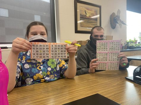 Brynn and Tyler hold up their easter bingo cards!