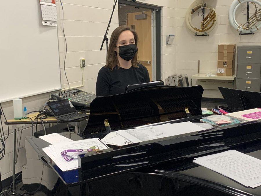 NUHS choir teacher Mrs. Koehler directing choir