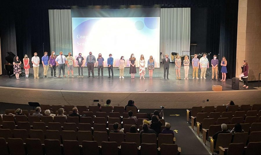 New Ulm High School band and choir seniors stand as they get nominated for music awards. These include their dedication and involvement with their high school music careers