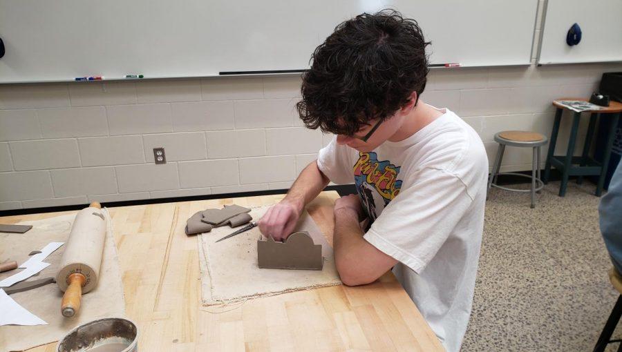 Vinnie Leske making a box in Pottery class.