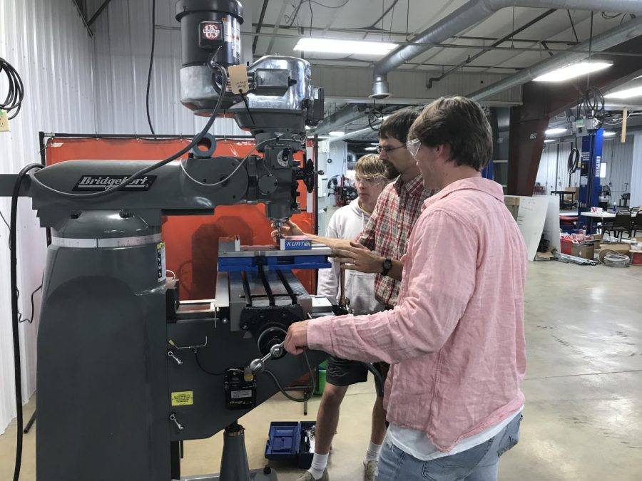 Down at the C.T.E. center recently, shop teacher Lindsey Johnson shows students how to properly zero in on an edge on one of the new mills the school has acquired. The goal is to teach the students how to operate these machines independently and effectively so they can hopefully use this skill in the work force someday, Johnson said.